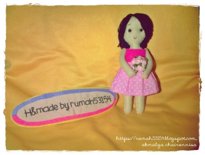 Cute handmade doll as a keychain
