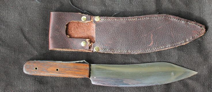 """first forged knife, was supposed to be about 8cm longer from the point. but the pattern welding started to delaminate enough to allow the scale formation to stuff it up. i was working it FAR too hot. so instead of a large """"camp knife"""" it is now my obligatory thing and scary sharp knife :-)"""