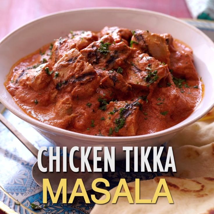 Chicken thighs are marinated in a creamy tomato curry sauce to make a flavor-packed Chicken Tikka Masala. Garnish with minced fresh cilantro, then serve over rice with naan!