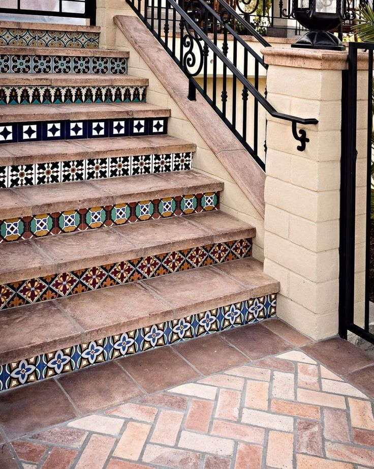 outdoor staircase with geometric tiled risers