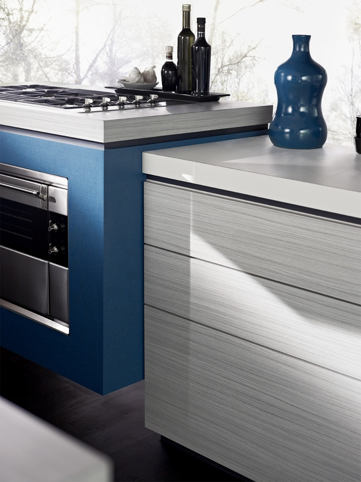 Drawers Laminex Chalky Teak (009). Benchtop Laminex Alpaca (004). Oven surround Laminex Hydra Mesh (014). Styling Wendy Bannister. Photography Earl Carter.