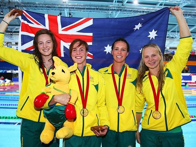 Cate Campbell, Bronte Campbell, Emma McKeon and Melanie Schlanger of Australia celebrate their world record and gold medal. Glasgow Commonwealth Games 2014