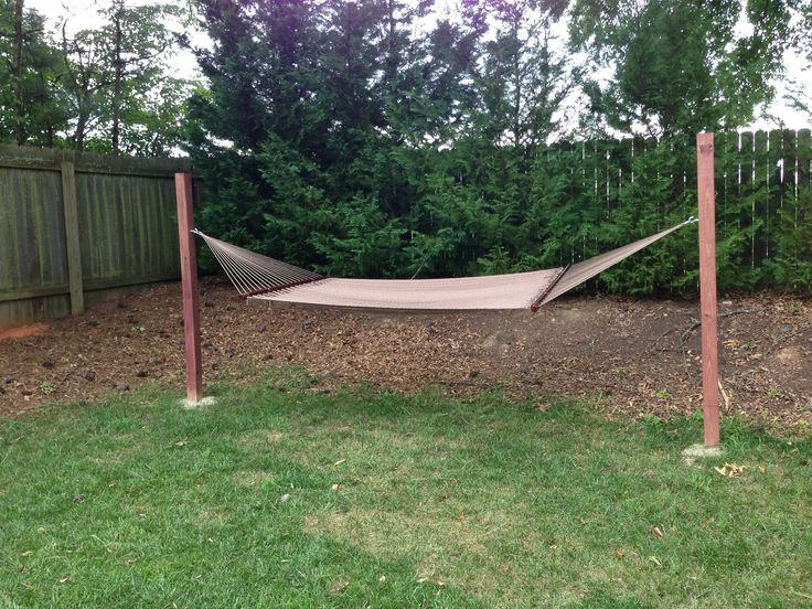 I don't have trees for a hammock and didn't want a metal frame so just an easy DIY project. 2, 4x4 posts. 8 ft tall each. 3' into the ground with cement. Then just 2 screw hooks and that's it!   A hammock with spreader bars should be hung between 4-5 feet off the ground so mine is around 4 1/2.  Tip: Rent or borrow an auger if you can, especially if you live somewhere with harder soil. The depth of the posts is key!
