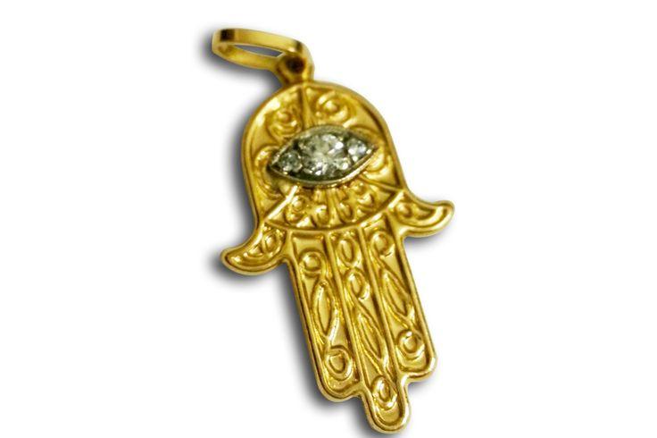 18 KARAT YELLOW GOLD 'HAMSA' HAND CHARM WITH EVIL EYE DETAIL.