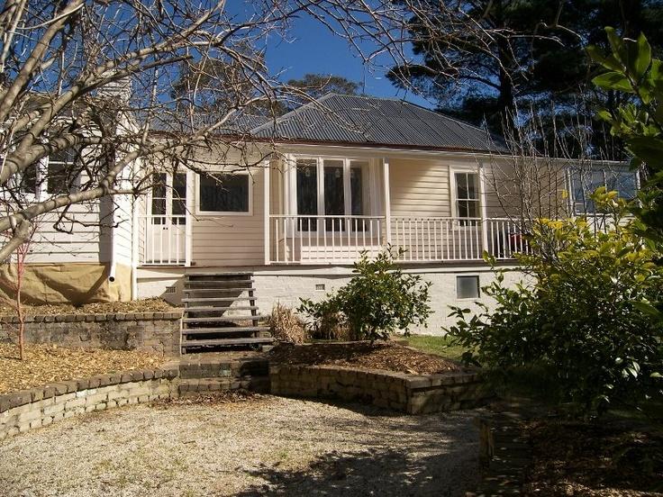 Weatherboard cottage + large windows