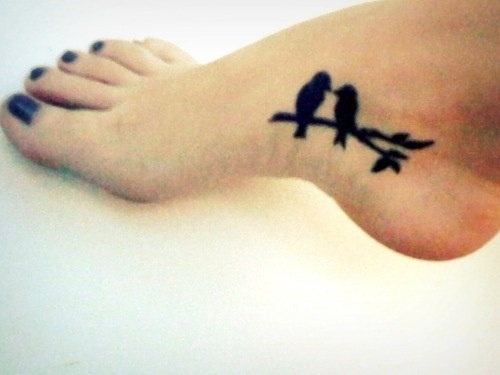 Bird black ankle tattoo - that's more like foot!