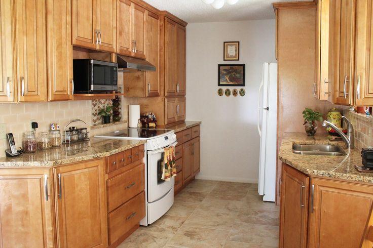 Kitchen design with beige tile floor peach subway tile for Peach kitchen ideas