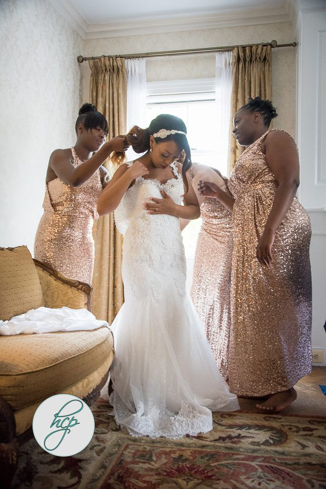 A Photo With Your Ladies Helping You Into Wedding Gown Is An Absolute Must Have