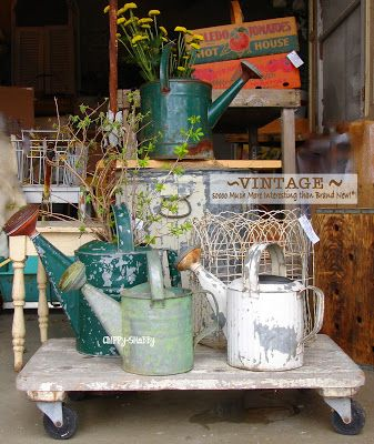 Super Cool Vintage Watering Cans (love that cart too!)