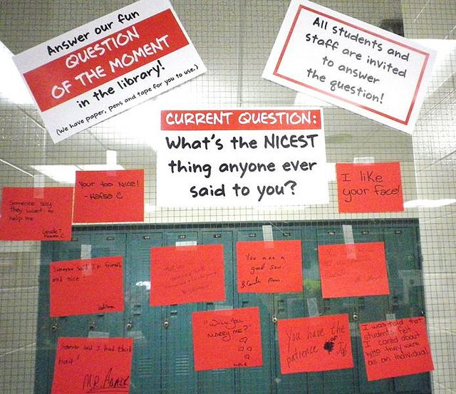 Question of the Moment in the library display. Students and staff answer on sticky notes.