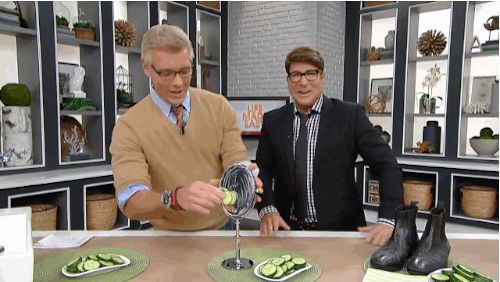http://www.cbc.ca/stevenandchris/life/2014s-best-moments-on-our-show 2014 best moments on S&C Chris Hyndman laughs as Steven Sabados cleans a mirror with a cucumber.