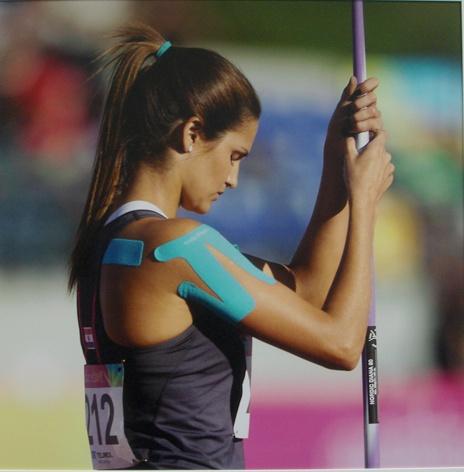 Javelin thrower Leryn Franco wearing a SpiderTech shoulder pre-cut.