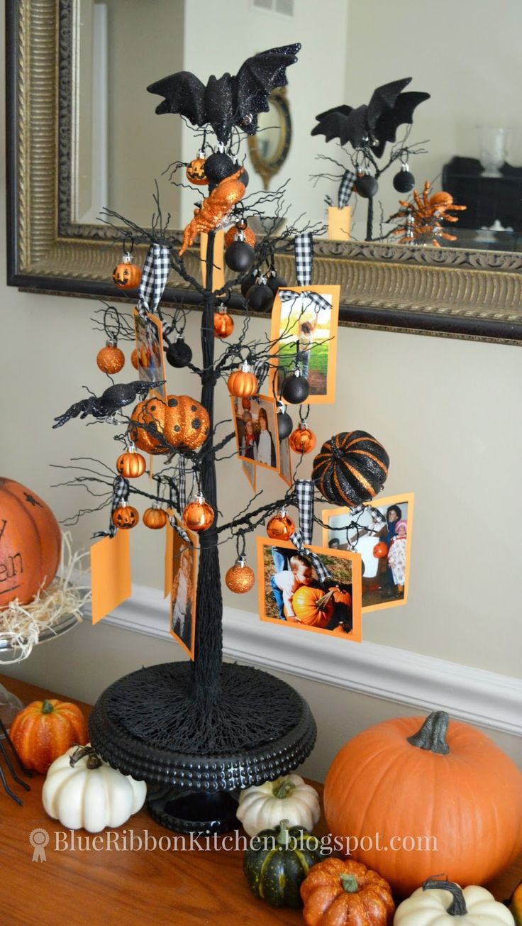 Blue Ribbon Kitchen: HALLOWEEN FAMILY TREE. Old Halloween costume photos make the perfect autumn display.