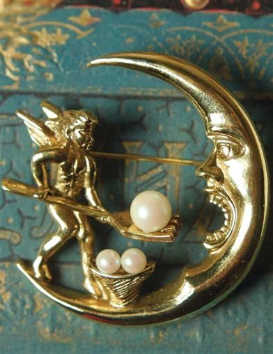 Crescent's Caviar brooch -- A diligent angel forks over the pearls to make the new moon full