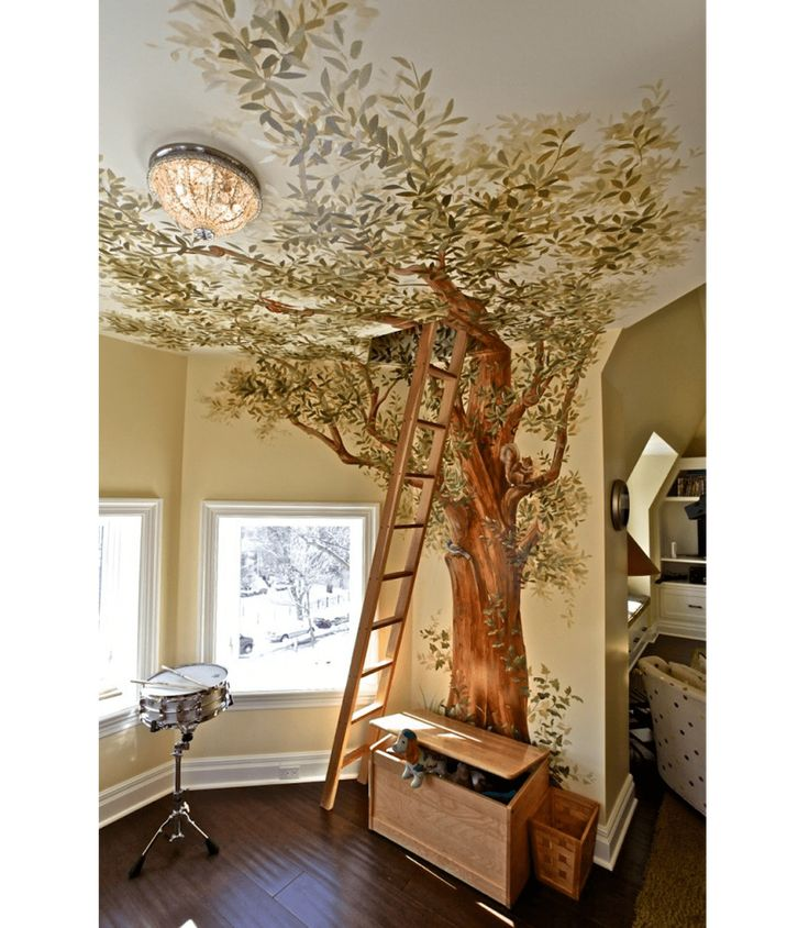 Trompe l'oeil mural of a tree covering the wall …