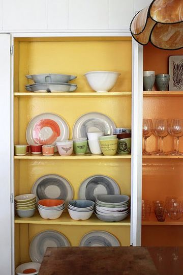 Painted kitchen cabinets - we could also paint cabinets white on outside and grey or fun pop of color on inside