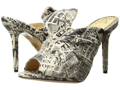 Charlotte Olympia Ilona High Heeled Mule Sandal.  Open-toe silhouette embellished by strap creating a bow-like textile applique knotted in the center. Eye-catching newspaper lettering and coloring throughout.  Made in Italy.
