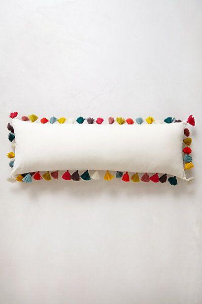 For a colorful Christmas pillow Firenze Velvet Tassel Pillow - anthropologie.com