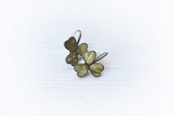 This is a vintage most unique connemara marble and sterling silver earring. Connemara marble jewelry was made in Ireland with the local most unusual olive green colour marble. The clover is also a local well loved good luck charm motif. These look like little lifelike Victorian earrings,
