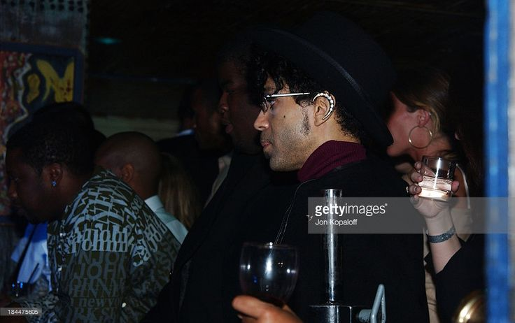 News Photo : Prince enjoys a performance by Stevie Wonder at...