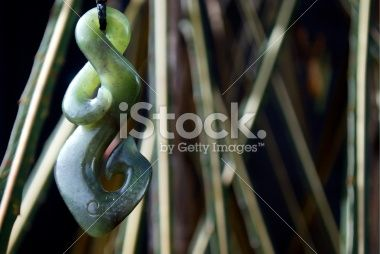 Greenstone (Pounamu) Double Twist Fish Hook Pendant Royalty Free Stock Photo