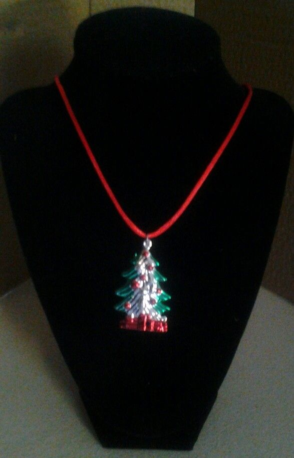 A Christmas tree on a red cord