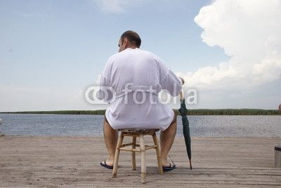 Hotel customer sitting on a stool in relax front the Danube Delta, Romania