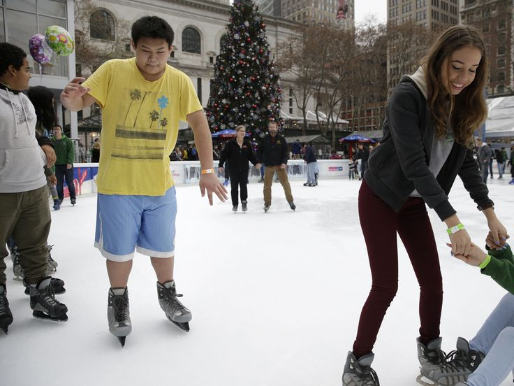 Ian Chan, 15, wears shorts and a T-shirt while ice skating at Bryant Park in New York on Dec. 23.