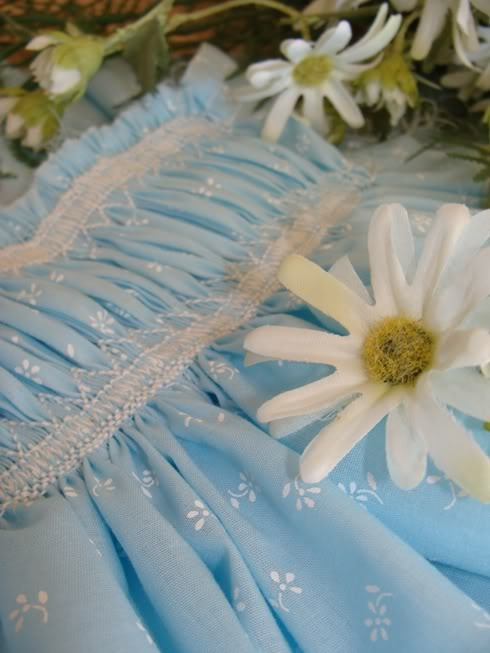 I love the white smocking on this blue patterned fabric.  And the plate is interesting, too.  By Laura Johnson.  The plate is free here http://ellieinspired.webs.com/smocked_tutorial.html
