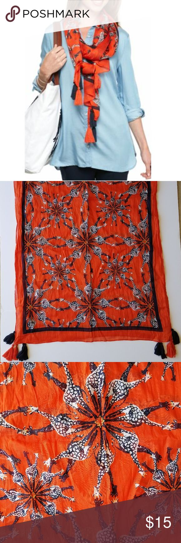 """Crown & Ivy Giraffe Medallion Scarf Amazing orange and navy Giraffe Medallion scarf from Crown and Ivy! Awesome giraffe print with tassels! This light weight scarf is perfect for layering anytime of year! The tassel details top of this standout piece! Approx 32""""W x 75""""L Crown & Ivy Accessories Scarves & Wraps"""