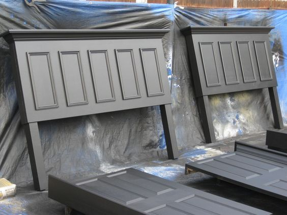 King and queen size headboards made from doors – both finished in satin black.