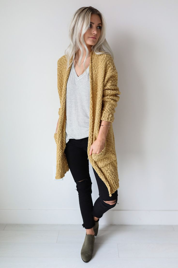 """• Mustard yellow cardigan with pockets • Available in S/M and M/L. Aspyn is 5' 4"""" and wearing a size M/L • 55% cotton, 45% acrylic"""