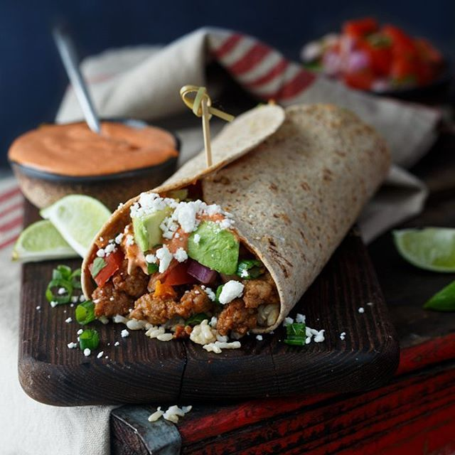 Korean Pork Burritos... packed with good stuff like kimchi, avocado, and gochujang aioli. Side nite…