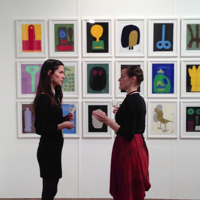 Two lovely ladies discussing and admiring works by Julian Martin at the Melbourne Art Fair, Royal Exhibition Building in Carlton, Melbourne.