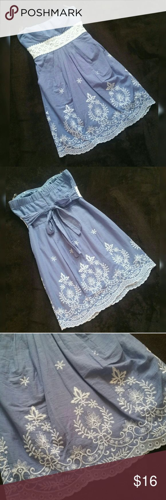 Strapless Sundress Beautiful light baby blue and white lace / crochet strapless embroidered sun dress Ties in back Padded bust Size 5 Very cute, could be worn with wedges, sandals, or cowboy / cowgirl boots for more of a country western look Made by Speechless Speechless Dresses Strapless