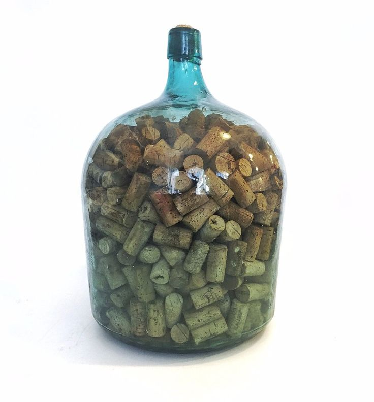 Green Glass Bottle Filled with Corks