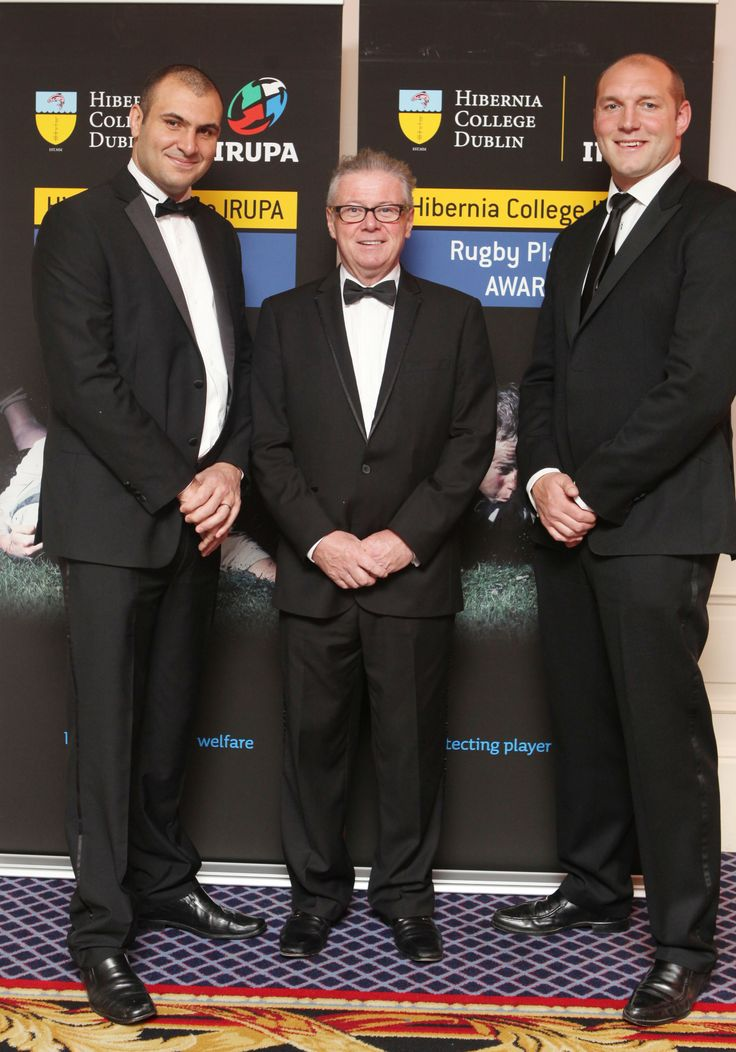 IRUPA CEO with Sean Rowland of Hibernia College and Awards MC Ben Kay.