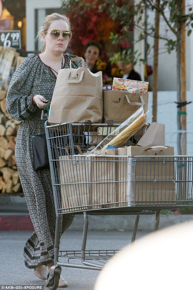 Trolley dash: Make-up free Adele wore a loose-fitting maxi dress to pick up groceries in Beverly Hills earlier in the week... after announcing plans for a second baby