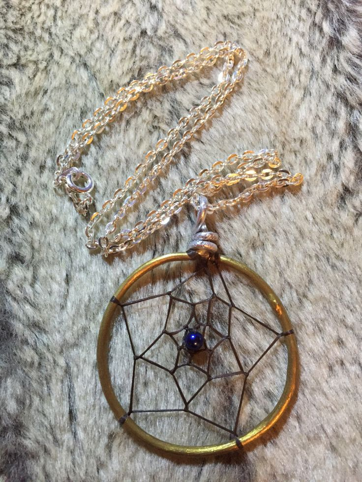 Hand wrapped, woven and painted gold and silver dreamcatcher pendant with blue glass pearl and 18' nickel free chain by EarthDiverCreations on Etsy https://www.etsy.com/ca/listing/483313608/hand-wrapped-woven-and-painted-gold-and