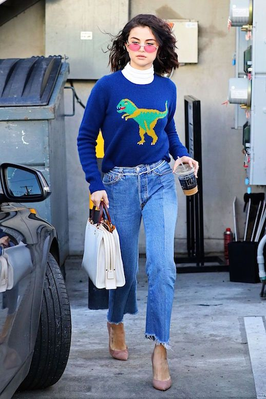 Photo via: Refinery29 Selena Gomez is the new face of Coach and we couldn't be more excited. The actress and singer stepped out wearing a turtleneck layered underneath the brand's whimsical dinosaur s