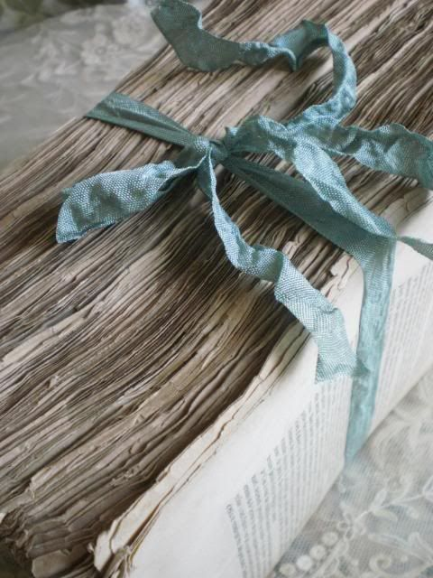 ♕ old French book pages bound with ribbon