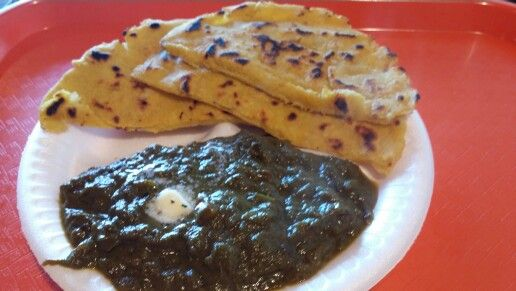 Maki Di Roti with Saag. Such a tasty Punjabi dish - the roti is made of corn meal, and the Saag is delicious spinach. Best food ever!