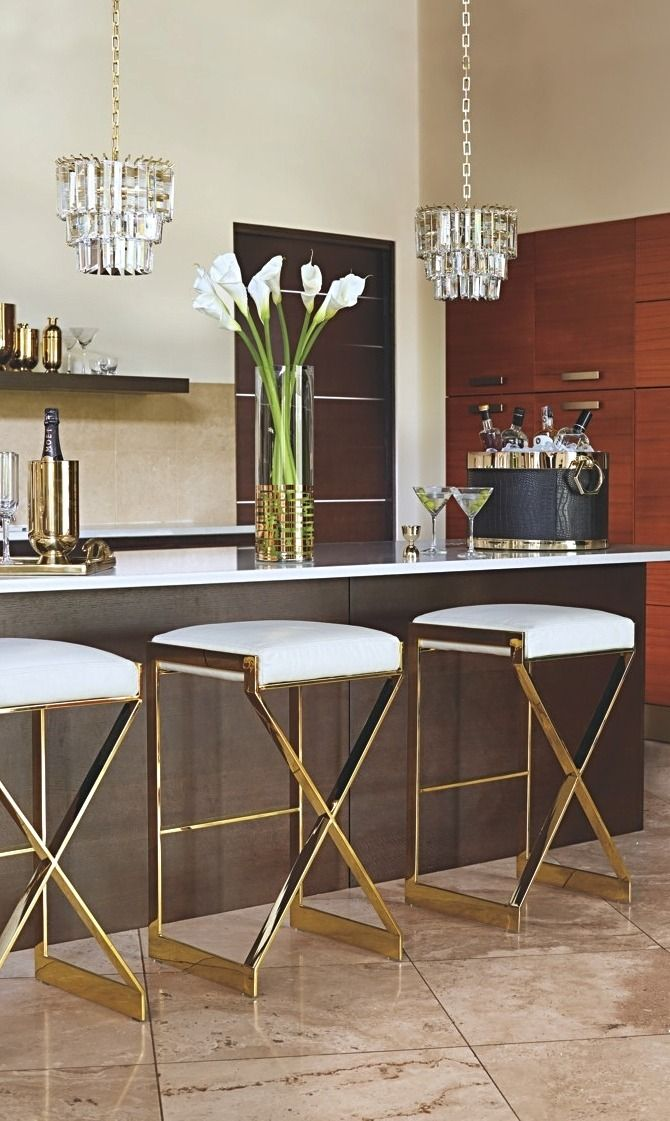 A monument to Regency Moderne, our Arrigo Barstool is built from glamorous metal, premium leather and a sleek X-frame base.