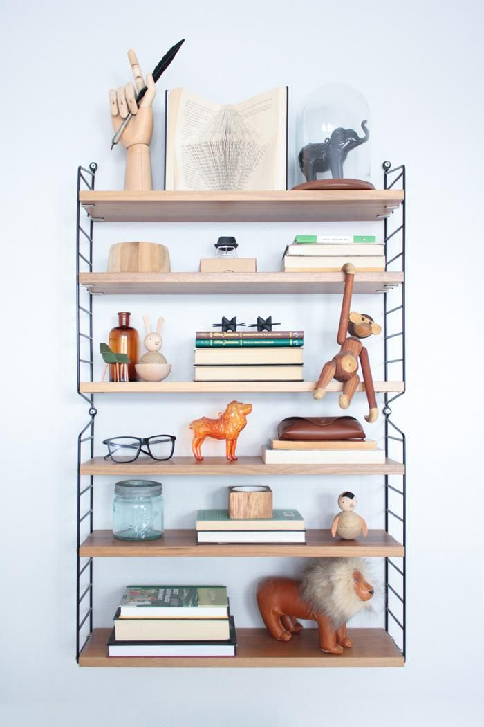Even your least-loved books can still serve a purpose — as risers in a coordinated display of knickknacks and keepsakes.
