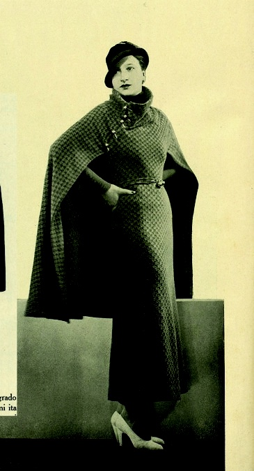 """Military-inspired chic: the influence of the regime was obvious in much 1930s fashion. As one magazine commented, """"the cape is generally inspired by the officer's rounded cloak, and the decorations often recall braid, loop fastenings and buttons."""""""