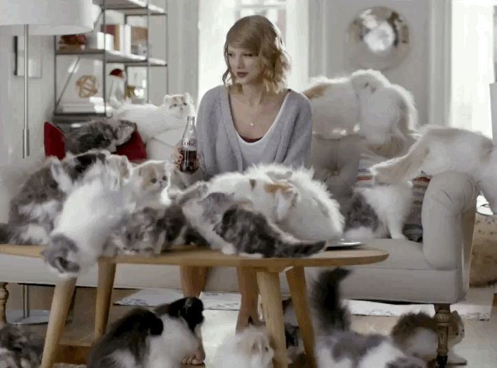 In their latest ad that drops this Friday, Taylor Swift is seen hanging out with a few (hundred) of her favorite furry friends. | Listen To This Sneak Peek Of An Unreleased Taylor Swift Song