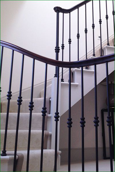 Cresswell Staircase - softwood cut string staircase painted white with a curved single bottom winder turn.