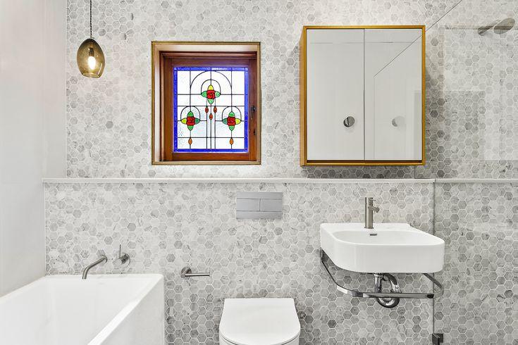 Modern bathroom design, classic bathroom, mosaic feature wall, marble tiles, white and grey bathroom, freestanding bath, in-wall cistern toilet, brushed tap ware, heritage bathroom, Luke's bathroom renovations,