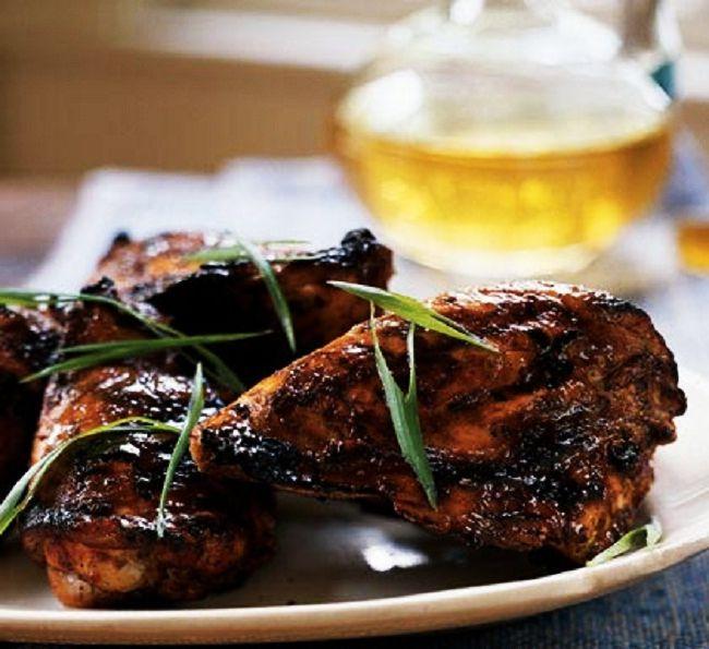 Jerk Chicken - Jamaican style grilled chicken served with spicy sauce...