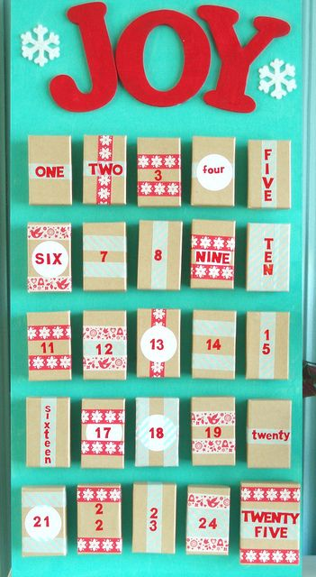 Make your own advent calendar out of jewelry boxes, craft paint and a wood board.